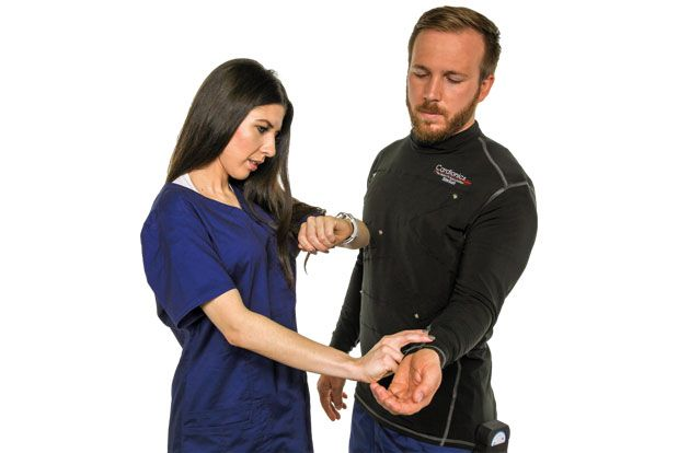 woman with cardionics bionic hybrid simulator (BHS) with SimScope™ checking pulse